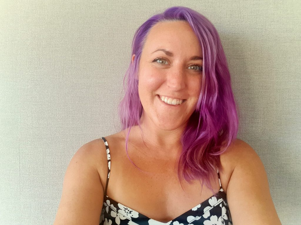 Selfie image of Brittany Baker with purple hair